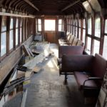 Interior of 168 looking from baggage end.  Original interior paneling was removed decades ago.